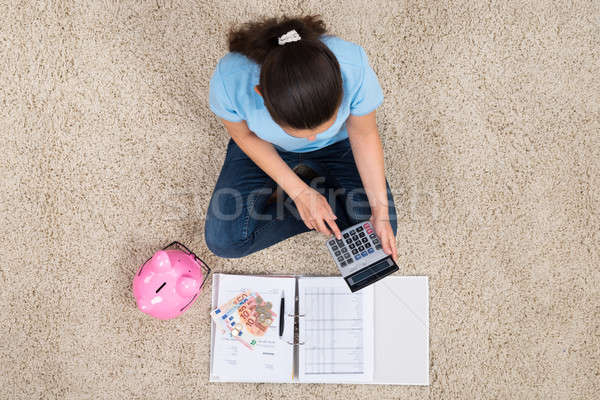Woman Calculating Budget Stock photo © AndreyPopov