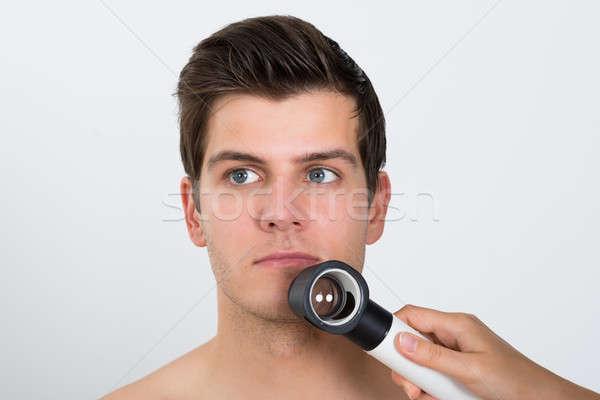 Person Examining Man Face With Dermatoscope Stock photo © AndreyPopov