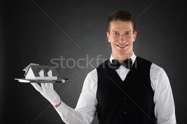 Waiter Holding Tray With House Model Stock photo © AndreyPopov