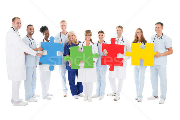 Confident Medical Team Holding Jigsaw Pieces Stock photo © AndreyPopov