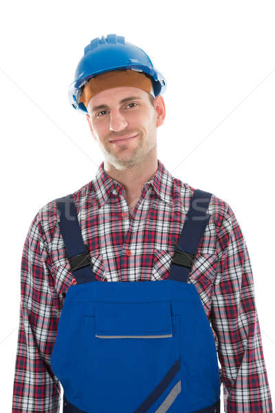 Portret glimlachend bouwvakker volwassen permanente witte Stockfoto © AndreyPopov