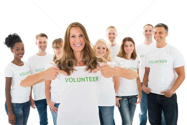 Happy Woman Showing Volunteer Text On Tshirt Stock photo © AndreyPopov