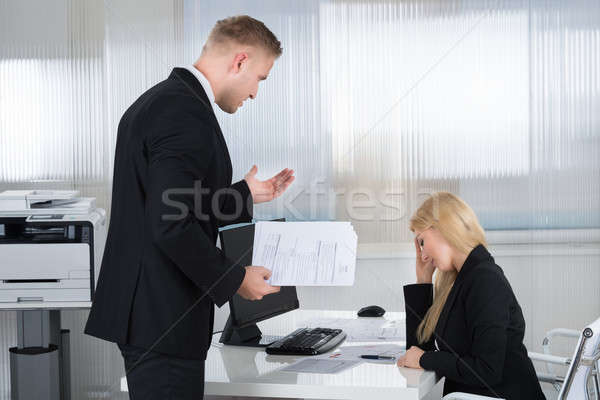 Stock photo: Businesswoman Yelling At Employee In Office