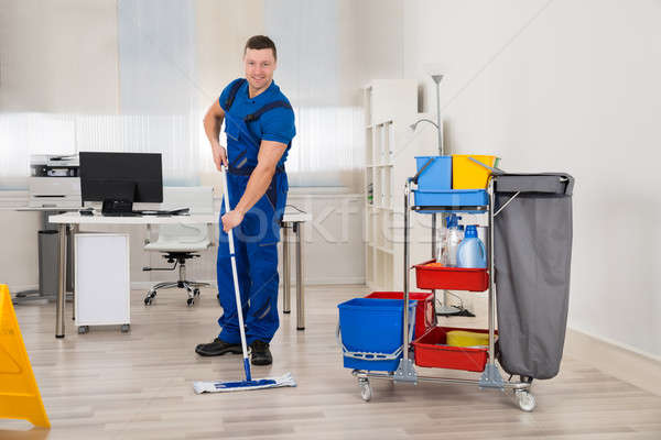 Janitor Mopping Floor In Office Stock photo © AndreyPopov
