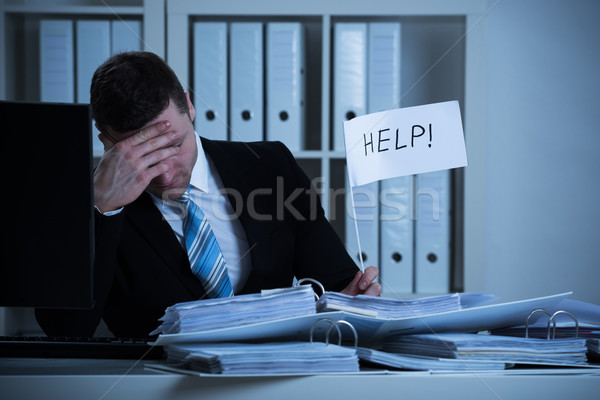 Stressed Accountant Holding Help Sign At Desk Stock photo © AndreyPopov