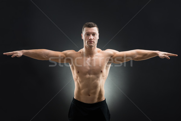 Confident Muscular Man Standing Arms Outstretched Stock photo © AndreyPopov