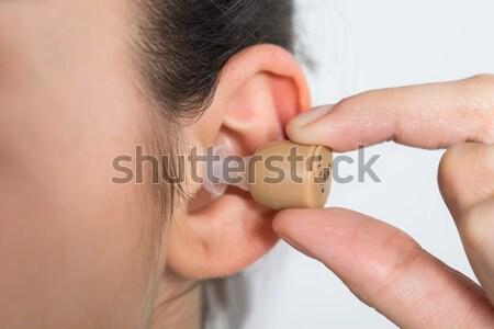 Stock fotó: Kép · nő · visel · hallókészülék · fiatal · nő · otthon