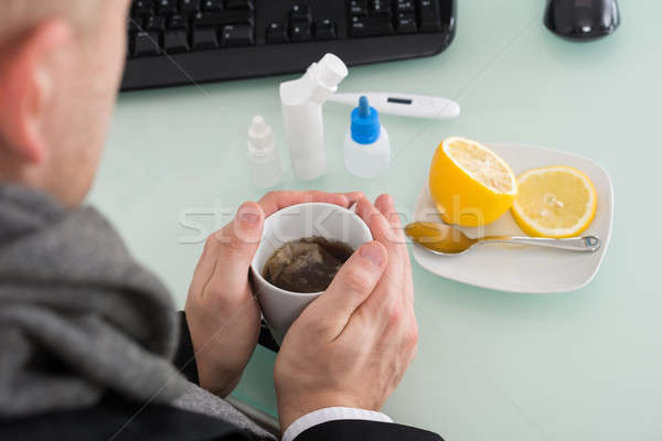 Businessman Holding Cup Of Tea At Office Stock photo © AndreyPopov