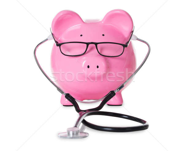 Piggybank With Stethoscope And Eyeglasses Stock photo © AndreyPopov