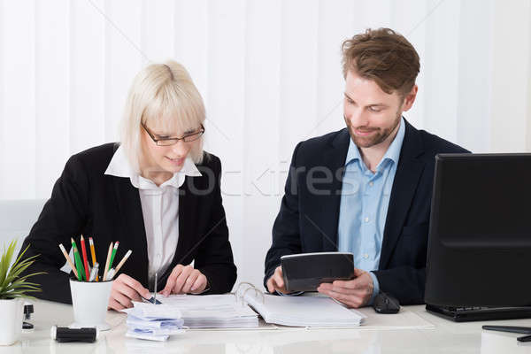 Two Businesspeople Calculating Bills Stock photo © AndreyPopov