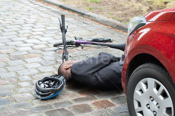 Cyclist Lying On Street After Accident Stock photo © AndreyPopov