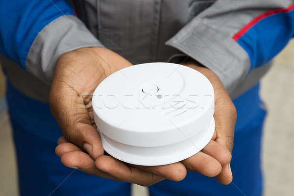 Electrician Holding Smoke Detector Stock photo © AndreyPopov