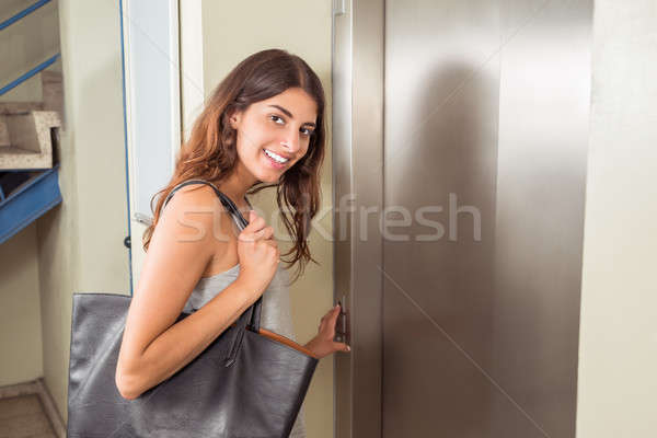 Woman Using Elevator Stock photo © AndreyPopov