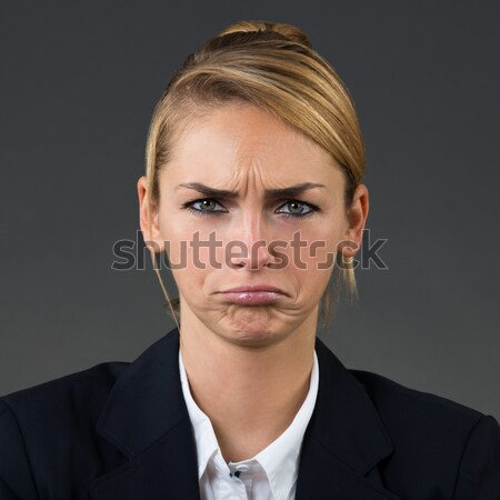 портрет несчастный деловая женщина молодые серый бизнеса Сток-фото © AndreyPopov