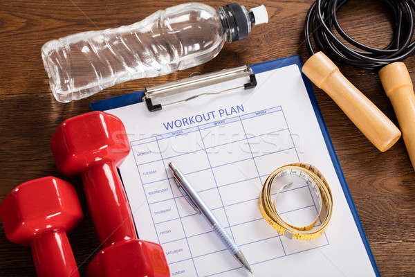 Workout Plan Form With Fitness Equipments Stock photo © AndreyPopov