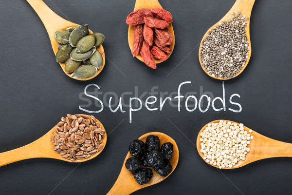 Superfoods Text With Ingredients In A Wooden Spoon Stock photo © AndreyPopov