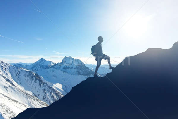 Hiker Hiking On Mountain During Winter Stock photo © AndreyPopov