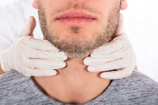 Man Getting Thyroid Gland Control Stock photo © AndreyPopov