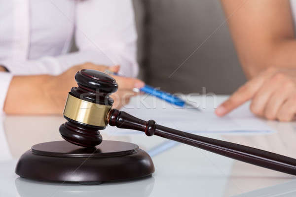 Stock photo: Couple Having Discussion Over Document In Courtroom