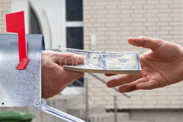 Personas mano dinero buzón primer plano cuadro Foto stock © AndreyPopov
