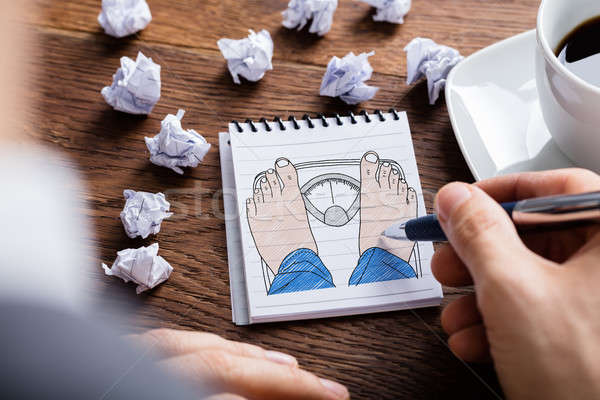 Hand Drawing Human Foot And Weighing Scale On Notepad Stock photo © AndreyPopov
