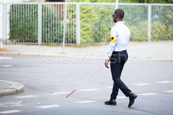 Blind Man Wearing Armband Walking With Stick Stock photo © AndreyPopov
