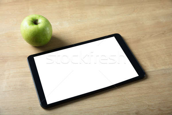 Elevated View Of Green Apple And Digital Tablet On Desk Stock photo © AndreyPopov
