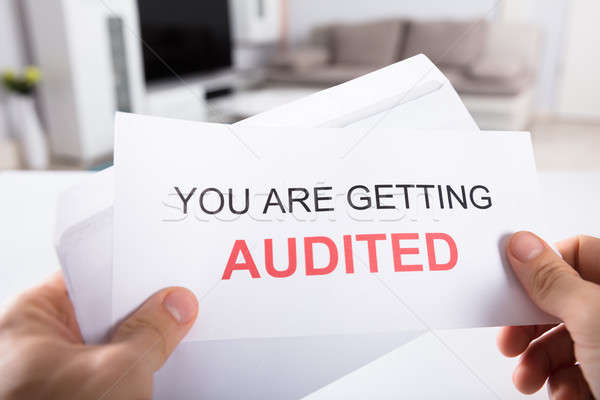 Person Holding You Are Getting Audited Notice Stock photo © AndreyPopov