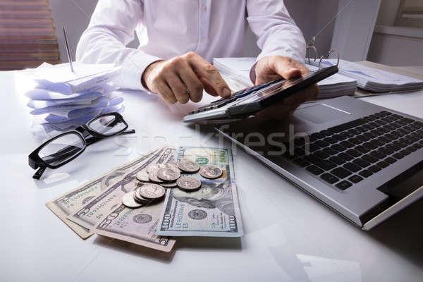 Empresário calculadora dólar moeda laptop Foto stock © AndreyPopov