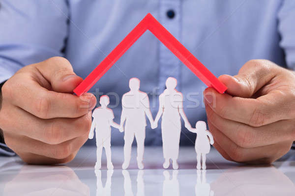 Person Holding Roof Over Family Paper Cut Out Stock photo © AndreyPopov