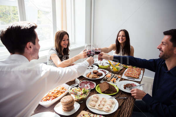 Stock photo: Happy Young Friends Toasting Wineglasses