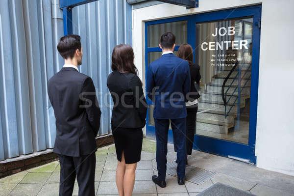 Gens d'affaires permanent entrée Emploi centre vue arrière Photo stock © AndreyPopov
