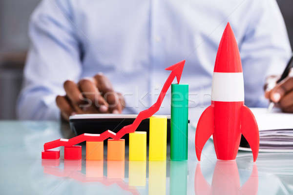 Increasing Graph With Rocket At Workplace Stock photo © AndreyPopov
