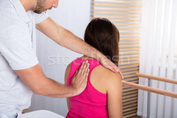 Therapist Massaging Woman's Back Stock photo © AndreyPopov