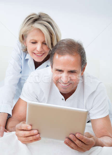 Stock photo: Happy Mature Couple Looking At Digital Tablet