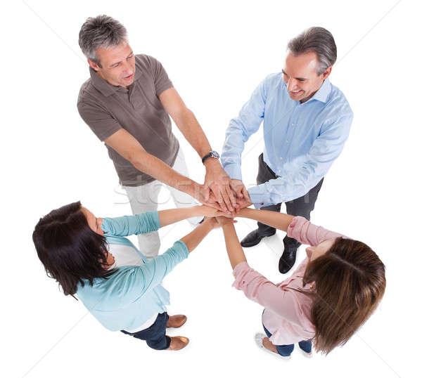 Business People Stacking Hands Over Each Other Stock photo © AndreyPopov