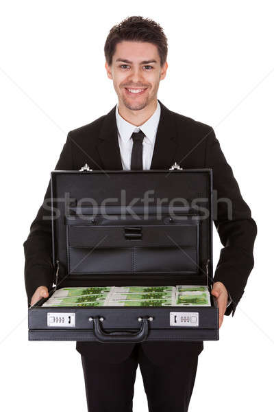 Businessman with suitcase full of cash Stock photo © AndreyPopov