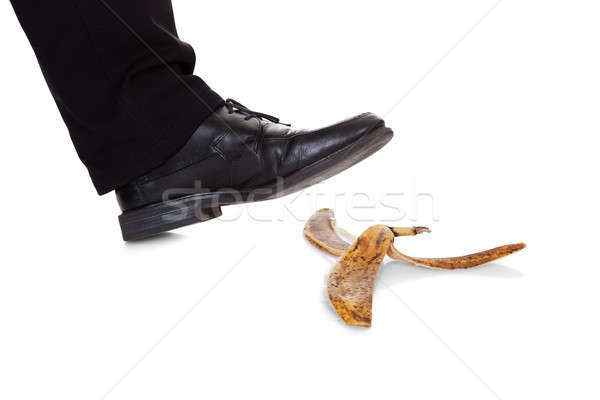 Businessman slipping on banana peel Stock photo © AndreyPopov