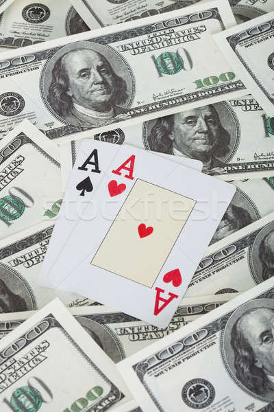 Pair of aces and american dollars Stock photo © AndreyPopov