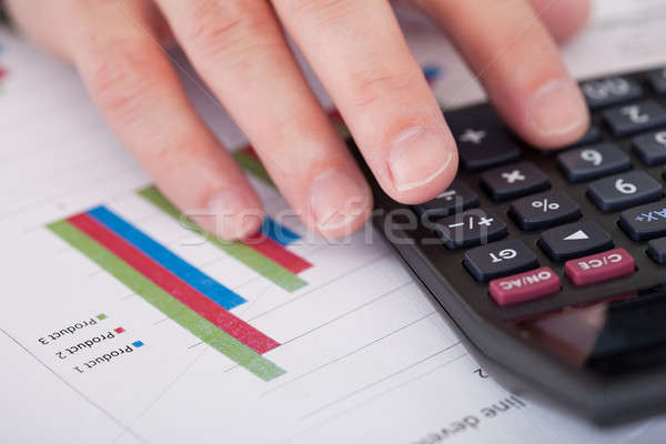 Close-up Of A Businessman Hand Analyzing Stock Charts Stock photo © AndreyPopov