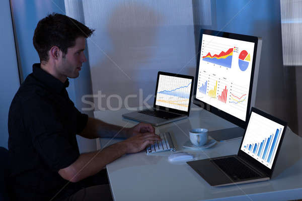 Young man working at computer Stock photo © AndreyPopov