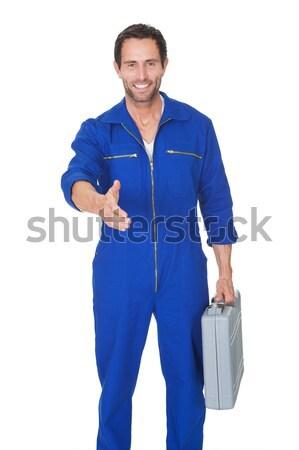 Portrait of happy automechanic writing notes Stock photo © AndreyPopov