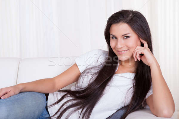 Smiling woman relaxing at home Stock photo © AndreyPopov