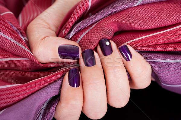 Beautiful purple female nails Stock photo © AndreyPopov