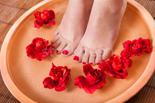 Female Feet Getting Aroma Therapy Stock photo © AndreyPopov