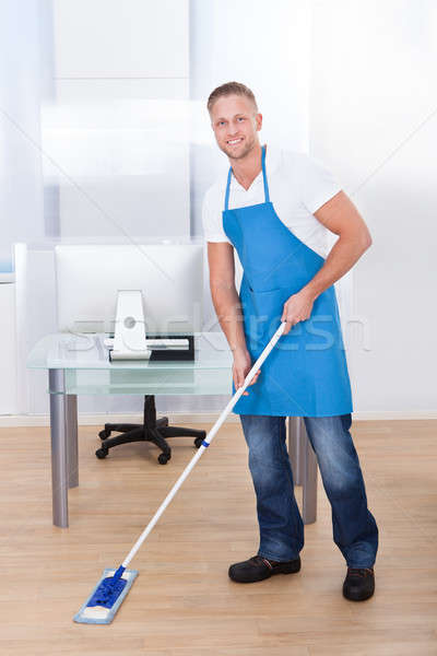Janitor cleaning the floor in an office building Stock photo © AndreyPopov