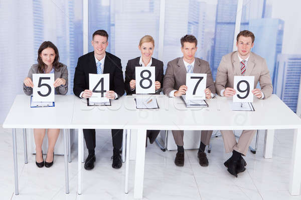Business People Showing Score Cards Stock photo © AndreyPopov
