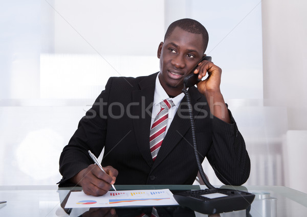 African Businessman Working At Office Stock photo © AndreyPopov