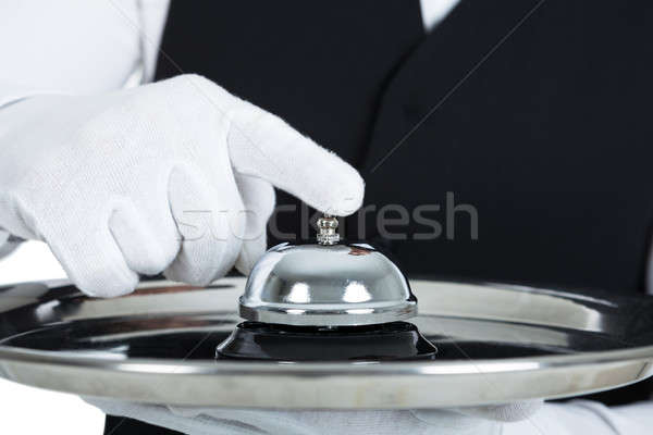 Butler Holding Service Bell Stock photo © AndreyPopov