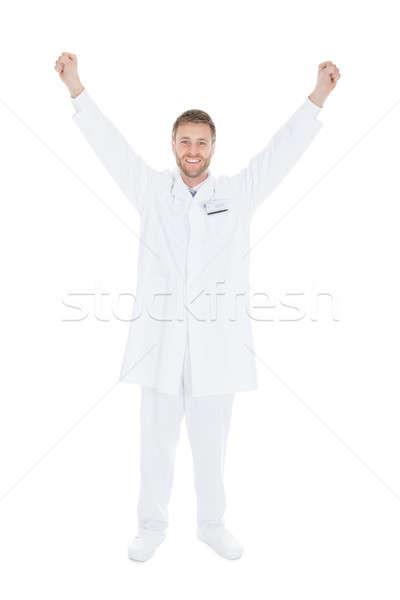 Sikeres fiatal férfi orvos karok a magasban teljes alakos fehér Stock fotó © AndreyPopov